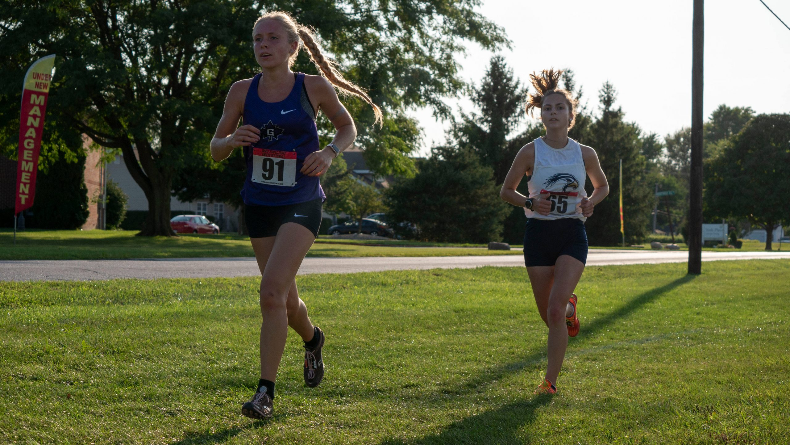 Annika Fisher speeding down cross country course