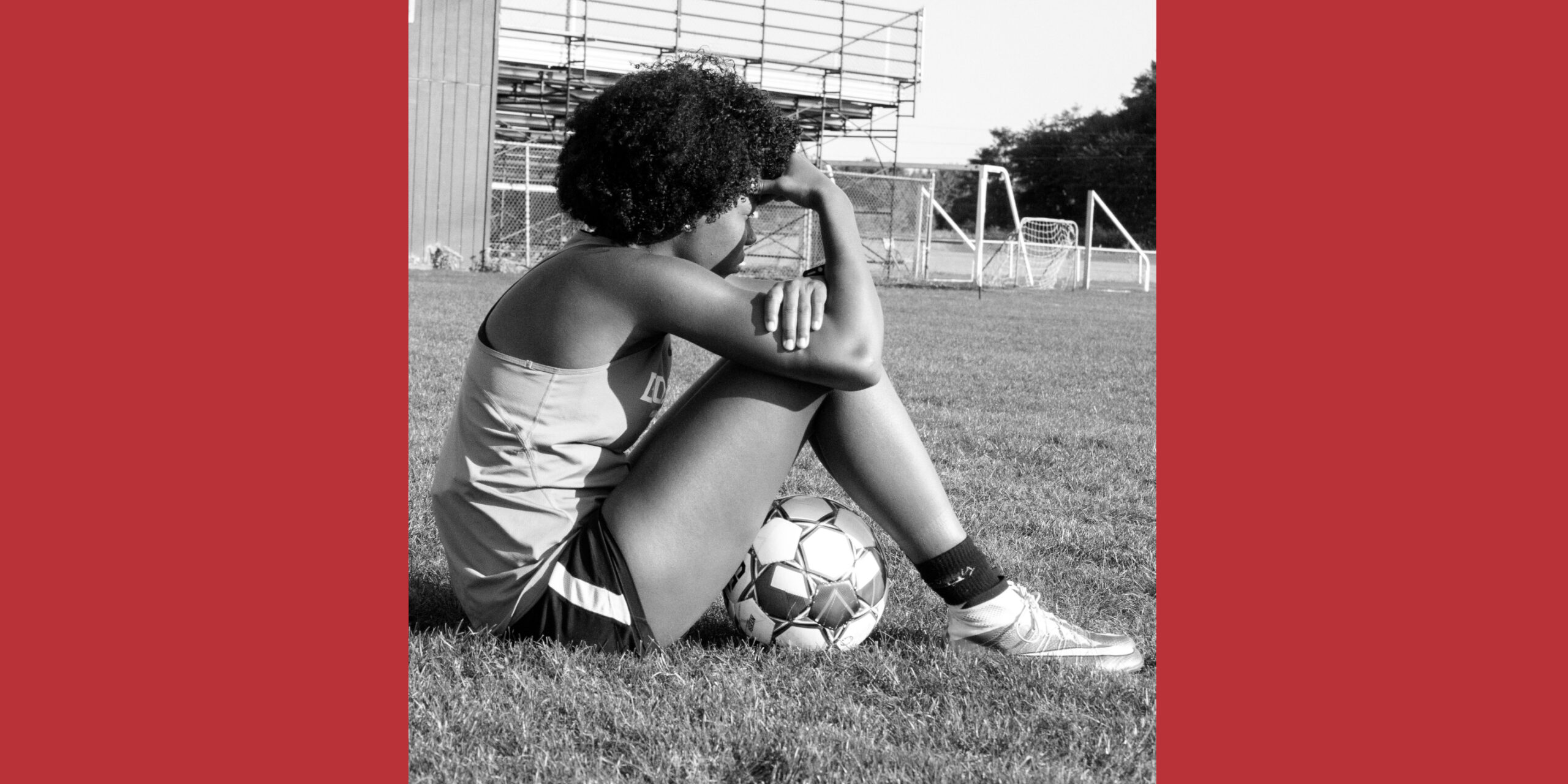 Soccer player on the sideline at practice