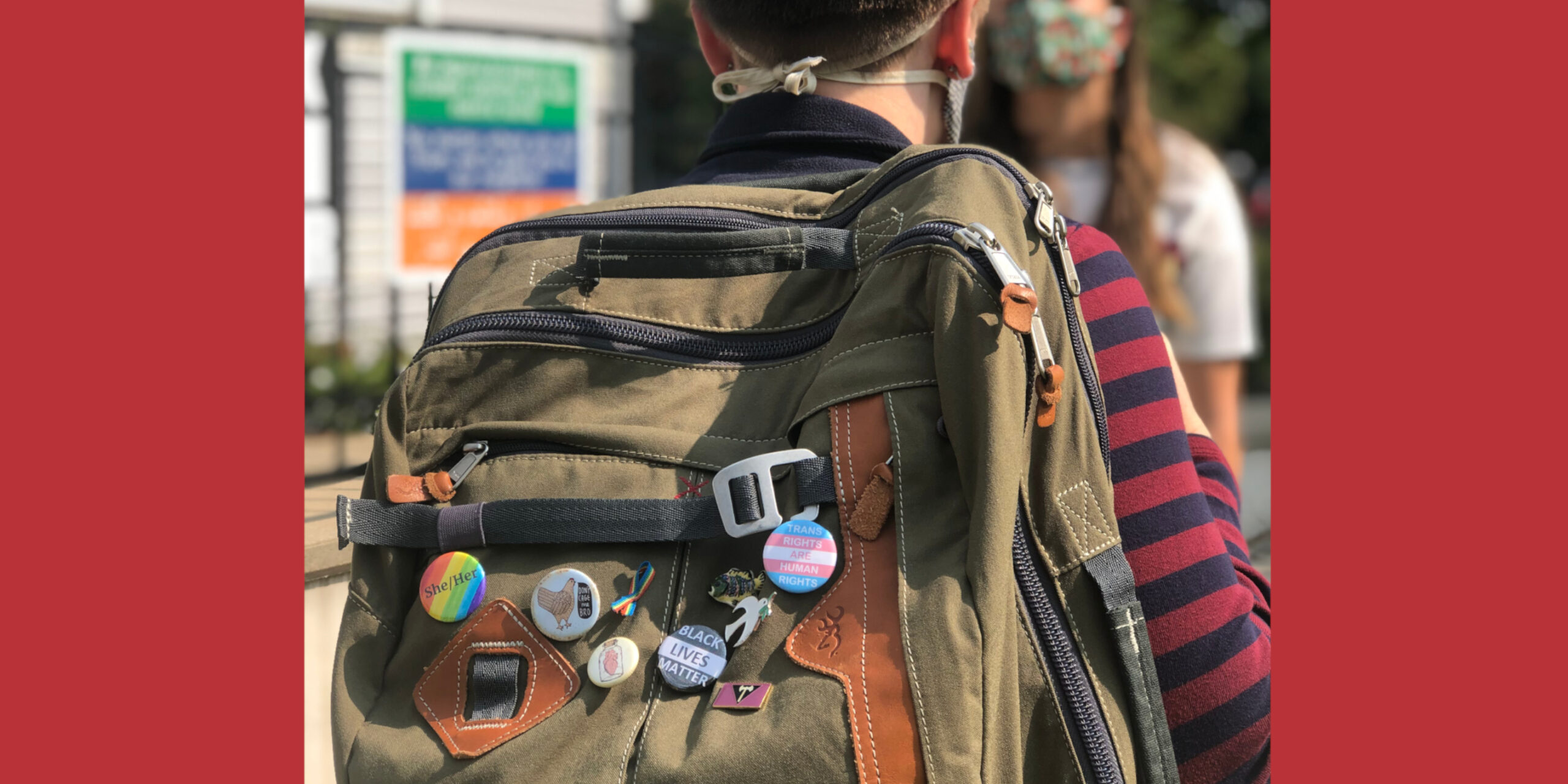 Backpack with pronoun pins on it
