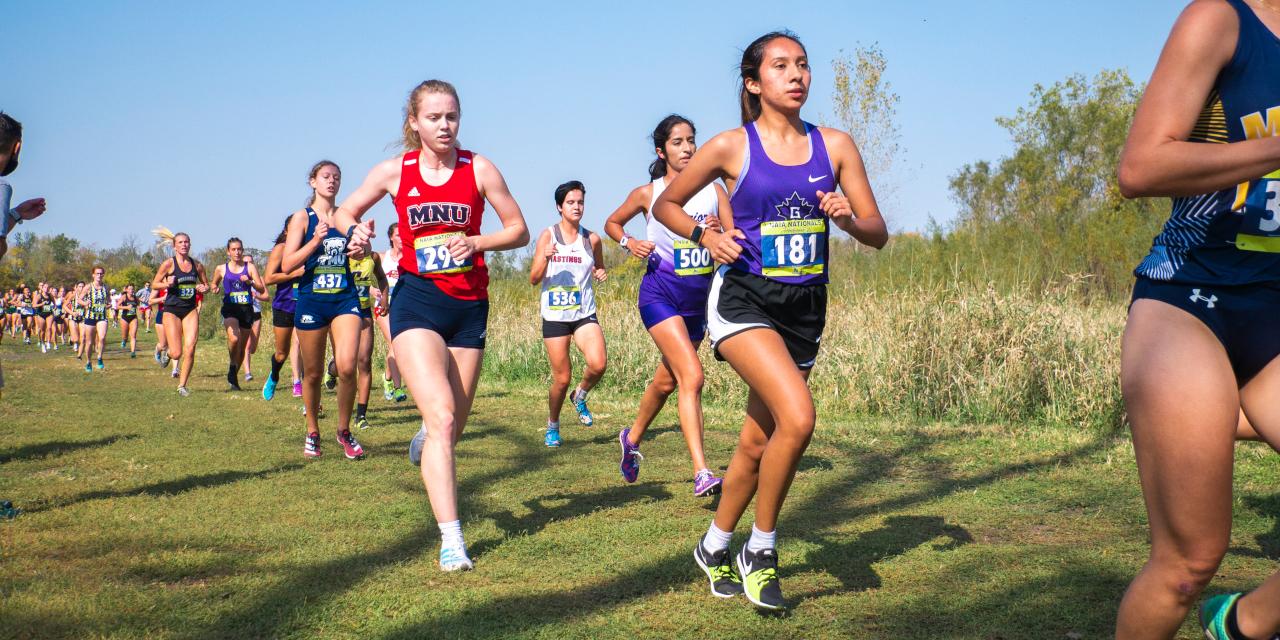 Celeste Arroyo running down cross country course