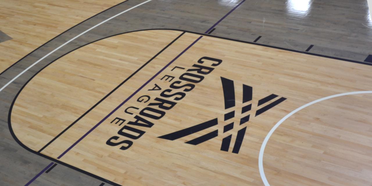 Basketball court with Crossroads League emblem