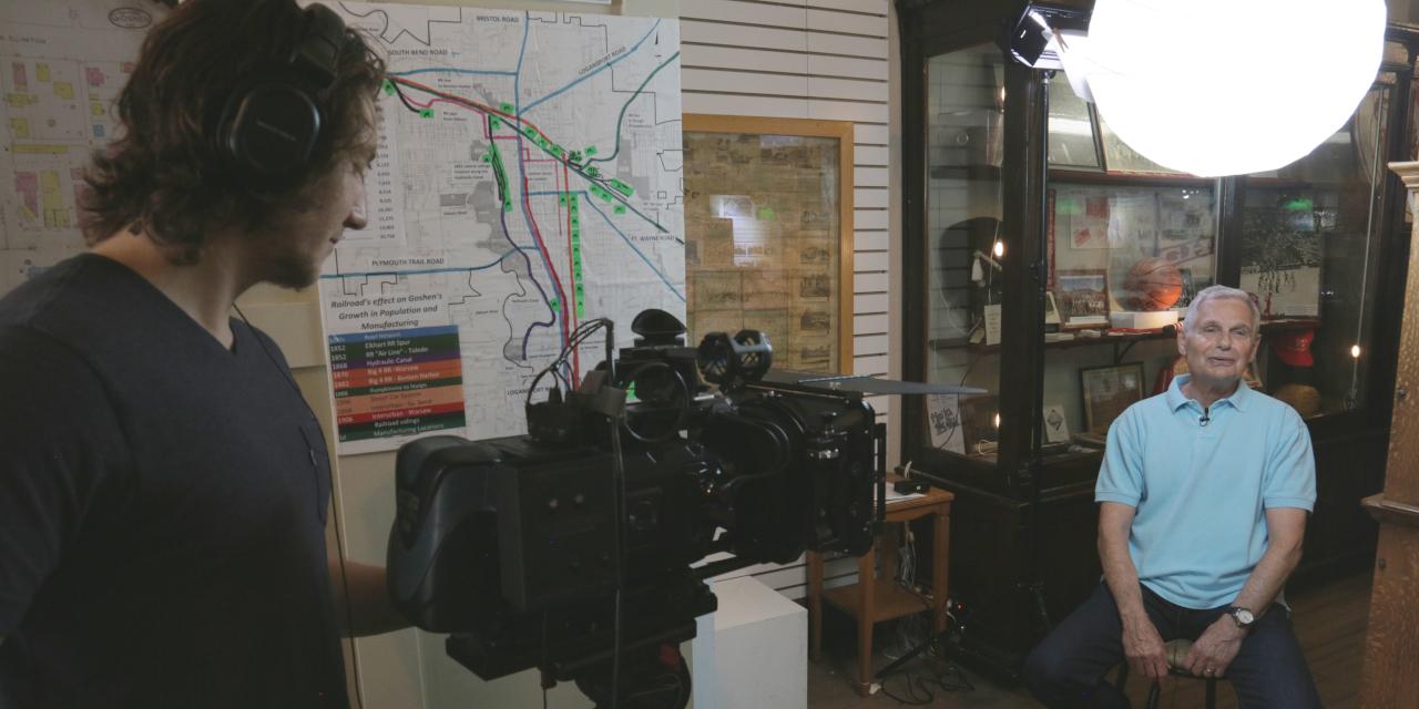 Student filmmaker recording an interview