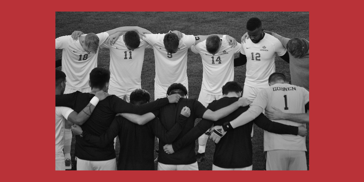 Men's soccer circles up for a pre-game prayer