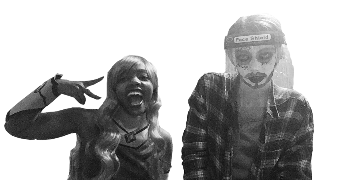 Black and white image of Cara Wilson and Kadie Spoor in their cosplay costumes. Cara Wilson is dressed as Starfire, a DC alien superhero. She throws up a peace sign for the camera. Kadie Spoor is dressed as Ghost Malone, with heavy white foundation, facial hair makeup, a flannel, and a face shield