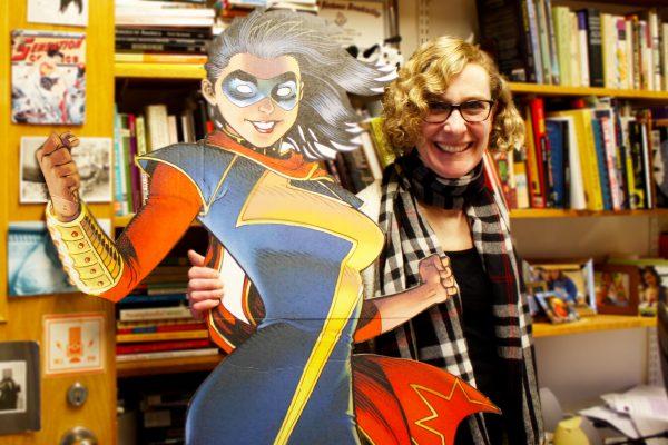 Jessica Baldanzi poses next to a life size comic character cutout