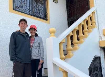 Caleb and Nina Longenecker Fox pose for a picture on the stairwell outside their house in Ecuador