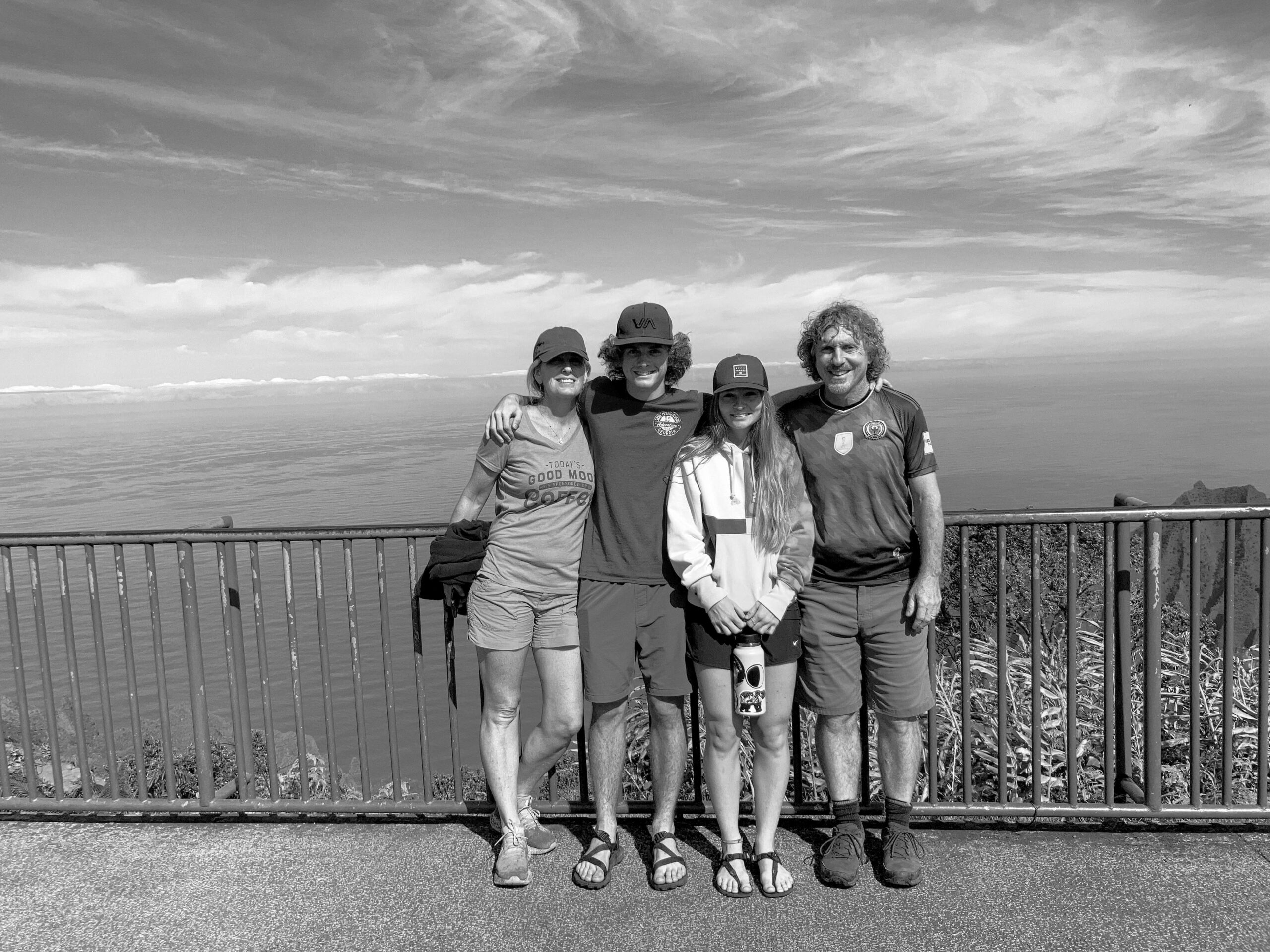 Black and white image of Jerell, Jane, Terresa and Jordan Ross Richer posing for a photo on an overlook