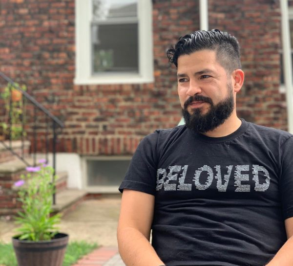 "Portrait of Raf Barahona wearing a ""Beloved"" shirt"