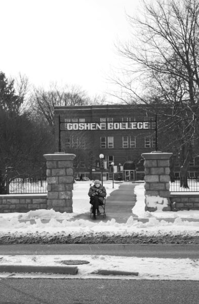 A photoshopped image of Bernie Sanders sitting under the Goshen College archway