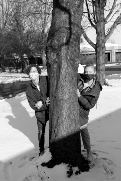 Caleb and Anna pose next to a tree for a picture