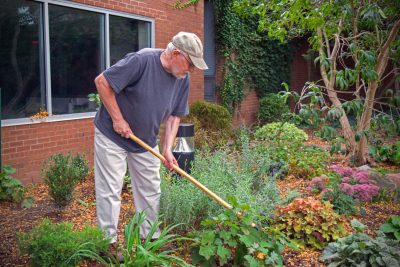 Ervin Beck tends to the Newcomer garden