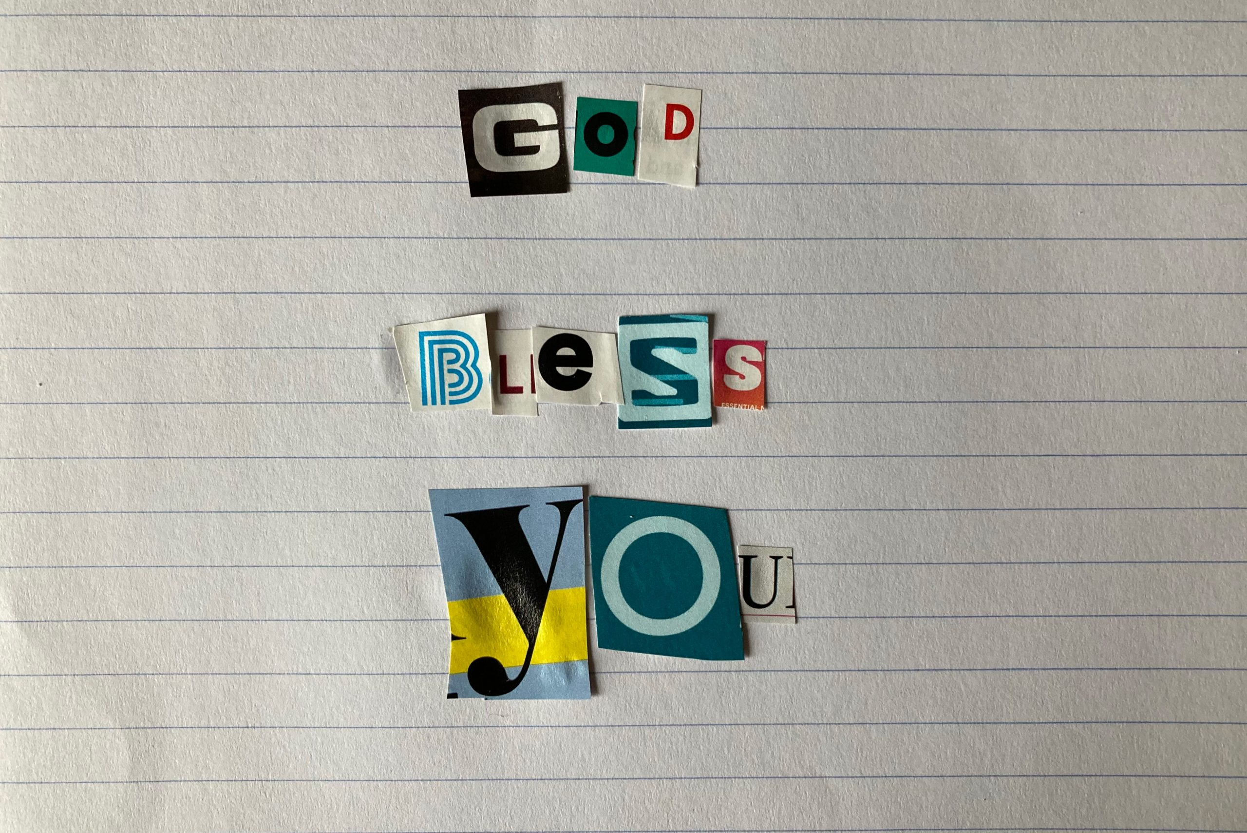 """Magazine letter clippings read """"God Bless You"""""""