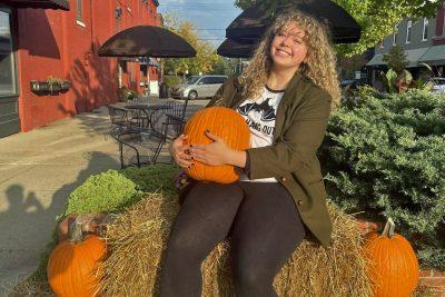 Olivia Ewry with pumpkin