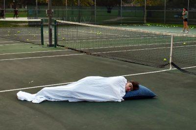Eli sleeping on tennis court